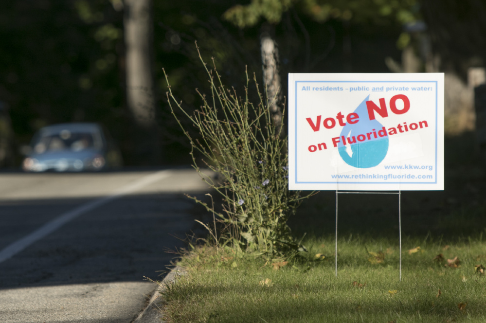 KENNEBUNK, ME - OCTOBER 5: Signs have sprung up on roadsides urging a no vote on a referendum asking residents in seven towns served by the Kennebunk, Kennebunkport and Wells Water District if they want to continue adding fluoride to drinking water. A forum will be held Monday in Kennebunk to discuss the upcoming referendum. (Photo by Gregory Rec/Staff Photographer)