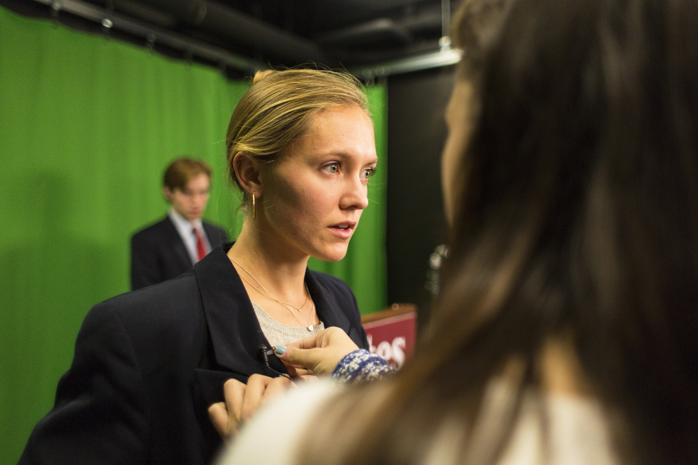 Molly Chisholm, playing a Republican candidate, prepares to make her TV address. As students take the rhetoric class, they also monitor the real presidential campaign.