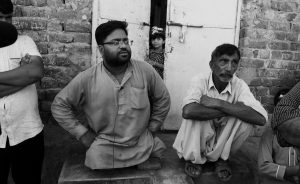 NEIGHBORS OF MUBEEN RAJHU, who killed his sister Tasleem, talk about the murder in Lahore, Pakistan on Sept. 1. Rajhu who couldn't stand the teasing, accusations and whispers from co-workers and neighbors that his sister was having an affair and with a Christian. The taunts were relentless.