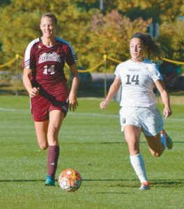 FORMER LISBON HIGH SCHOOL standout Kailyn Hill, left, of Maine-Farmington chases the ball along with Bowdoin's Nikki Wilson during a women's soccer game in Brunswick on Wednesday. The Polar Bears downed Hill's Beavers, 6-0.