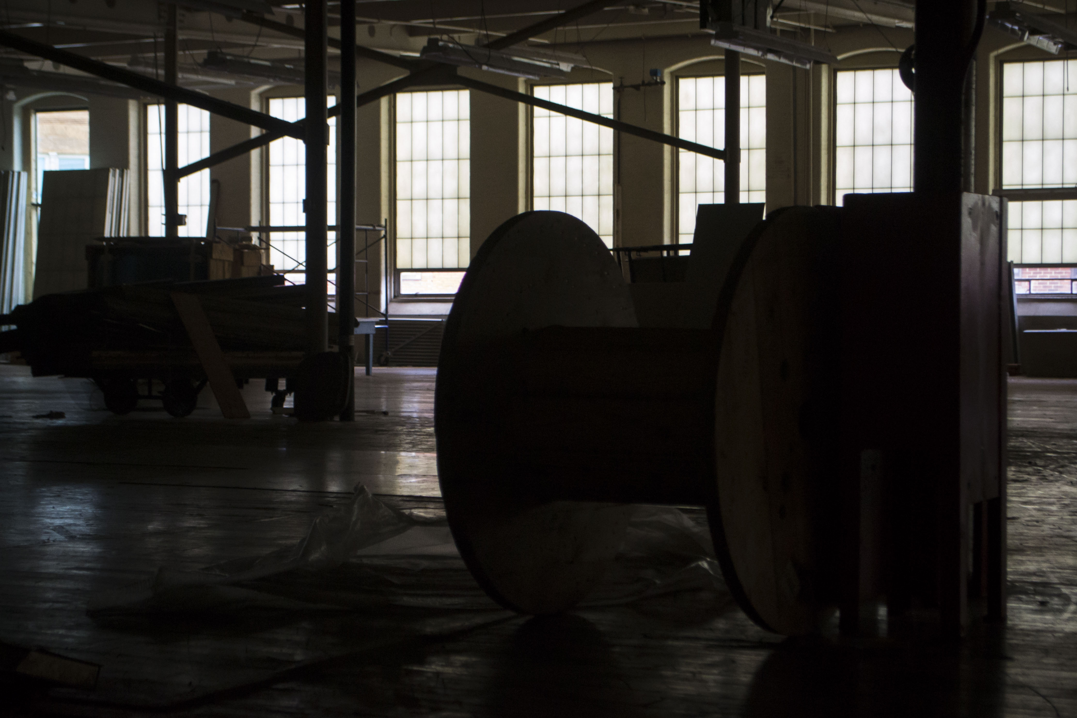 A large spool sits, right where it was left, in a vacant room of the Pepperell Mill. As work continues on the mill and surrounding buildings, sights like these are both reminders of the work that brought Biddeford to life and the look toward the future. ALAN BENNETT/Journal Tribune