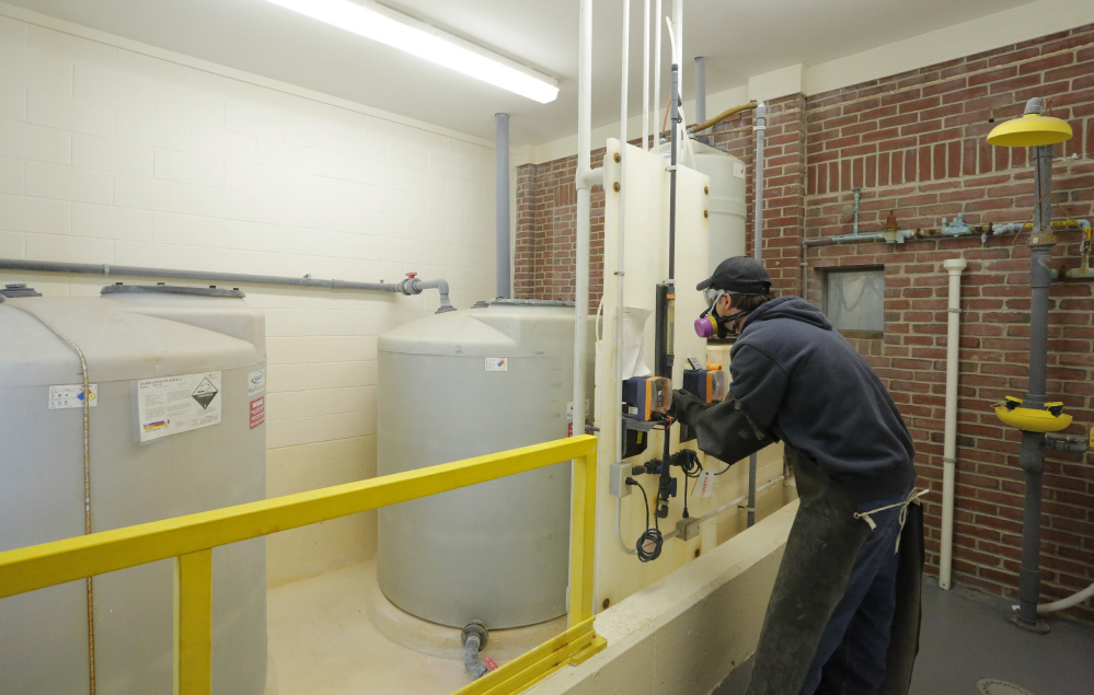 KENNEBUNK, ME - OCTOBER 5: Randy Nichols checks the feed rate of hydrofluorosilicic acid, a type of fluoride in tanks at left, as it is added to water at the Kennebunk, Kennebunkport and Wells Water District. A forum will be held Monday in Kennebunk to discuss an upcoming referendum in seven towns that asks residents if they want to continue to add fluoride to drinking water. (Photo by Gregory Rec/Staff Photographer)