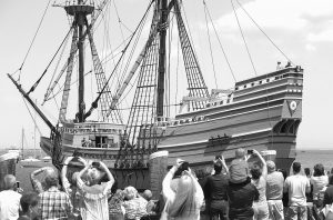 PEOPLE ON A WHARF watch as the Mayflower II arrives in Plymouth Harbor in Plymouth, Massachusetts. The 60-year-old replica of the ship that carried the Pilgrims to Massachusetts in 1620 was towed last week to Mystic, Connecticut, for major reconstruction that's expected to take 2 1/2 years.