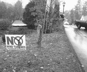 A YARD SIGN opposing an industrial wind project sits at the side of the road in Grafton, Vermont. Voters in Grafton and Windham are going to cast ballots Nov. 8 on whether to go forward with a plan for 24 turbines in the two communities.