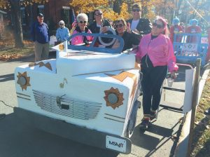 MAINE STATE Music Theatre shows off their Greased Lightning bed before Saturday's races.