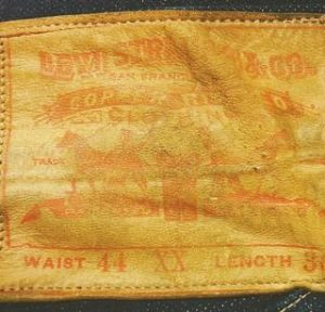 A LEATHER LABEL on a pair of 1893 Levi-Strauss denim blue jeans in pristine condition.