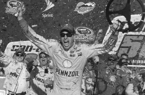 JOEY LOGANO CELEBRATES in the victory lane after winning the NASCAR Sprint Cup Series auto race at Phoenix International Raceway on Sunday in Avondale, Ariz.