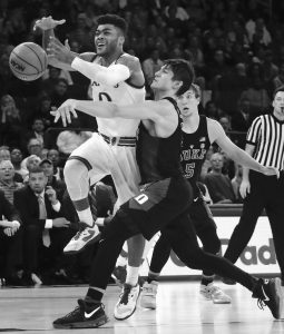 DUKE GUARD Grayson Allen, right, fouls Kansas guard Frank Mason III (0) as he strips the ball from Mason during the first half of an NCAA college basketball game on Tuesday in New York.