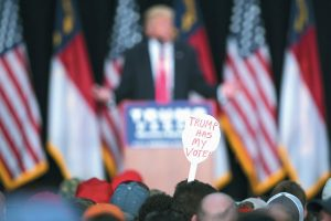 A SUPPORTER OF Republican presidential nominee Donald Trump holds a sign during a campaign rally in Winston-Salem, North Carolina. A Kaiser Family Foundation-CNN poll released in September compared white college graduates and the white, black and Hispanic working class. Working-class whites were least likely to say that they're satisfied with their influence in the political process, that the federal government represents their views, and that they believe their children will achieve a better standard of living than themselves.
