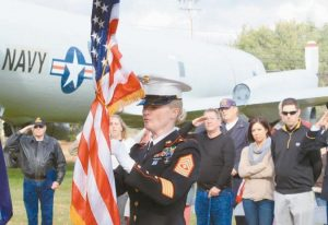 FIRST SGT. RYAN HAYES of the U.S. Marine Corps furls the flag at the conclusion of a Veterans Day ceremony at the P3 Park at Brunswick Landing in this 2014 file photo. Veterans Day observances will be held throughout the Midcoast on Friday.