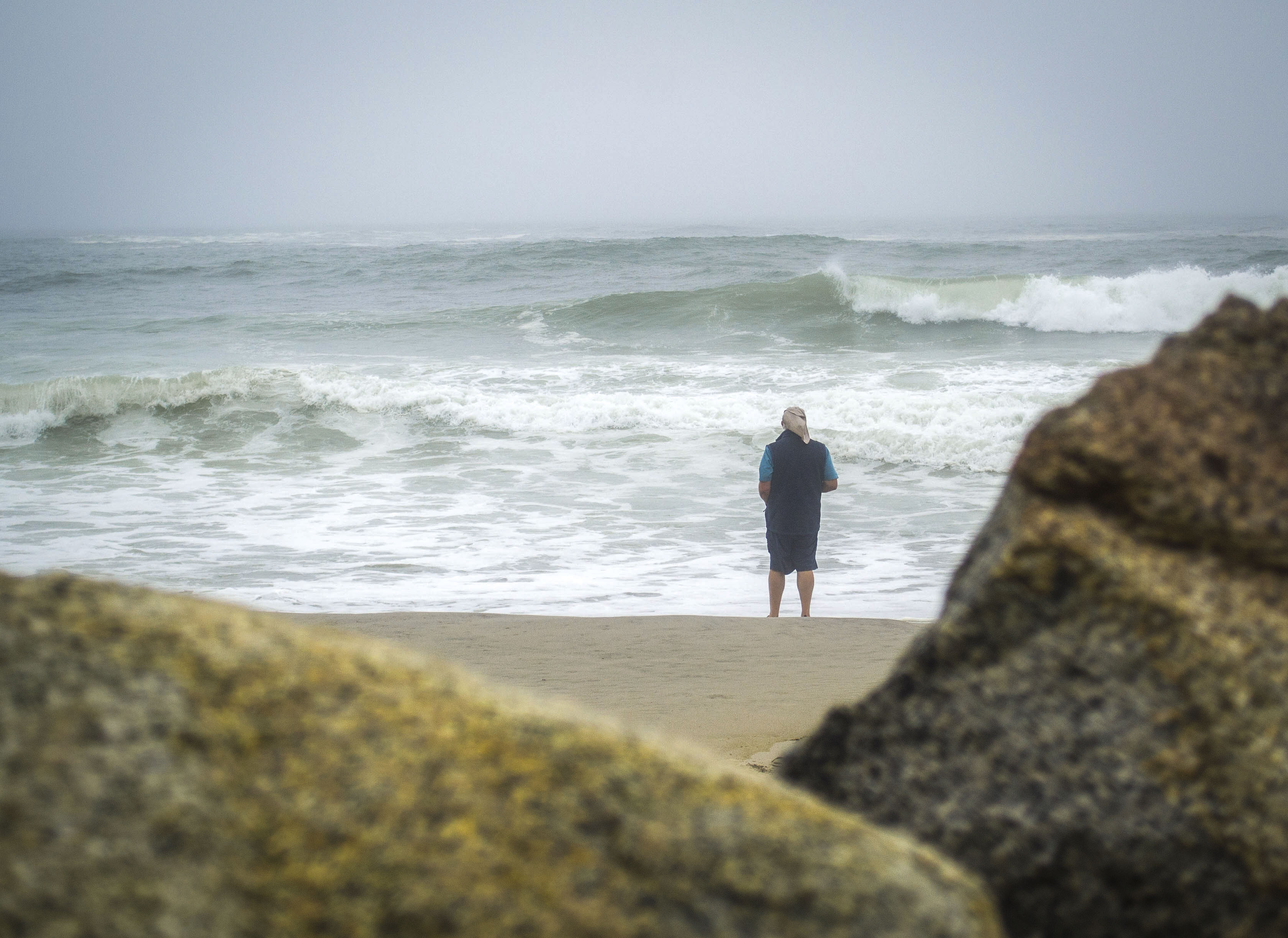A man looks out toward the Atlantic Ocean at Fortunes Rocks Beach on Sept. 6, as large waves crashed onshore during post-tropical storm Hermine. The highest-annual tides, the King Tides, are expected to arrive on Tuesday and Wednesday next week, bringing with them surges taller than 11 ft. ALAN BENNETT/Journal Tribune