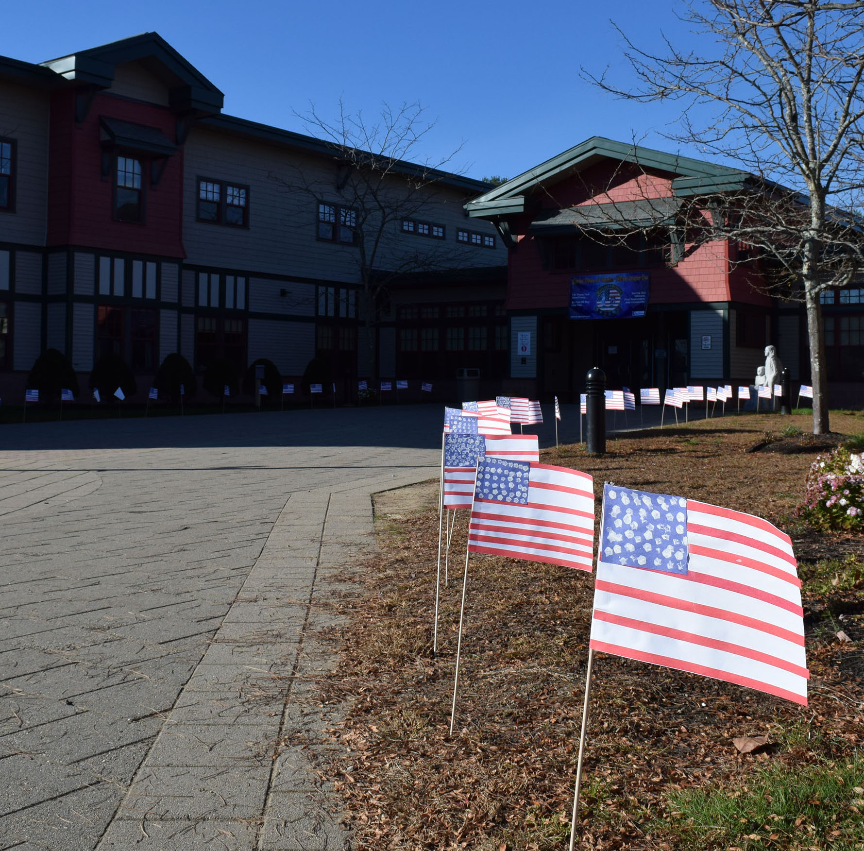 Student made flags greet guests outside Wells Elementary School on Nov. 10.