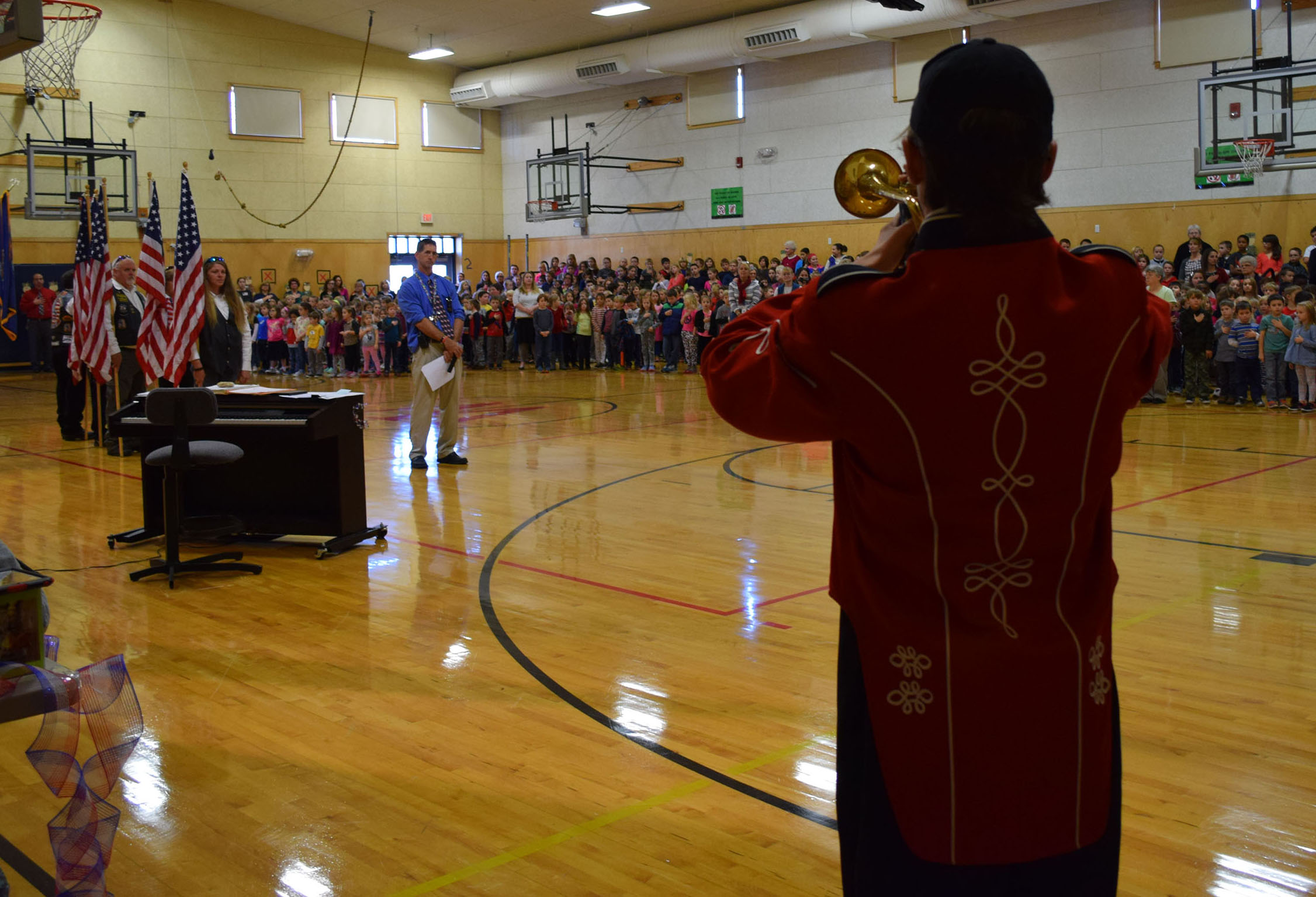 Wells High School student Kiah Holdsworth plays Taps at the Veterans K-4 Assembly at Wells Elementary School on Nov. 10.