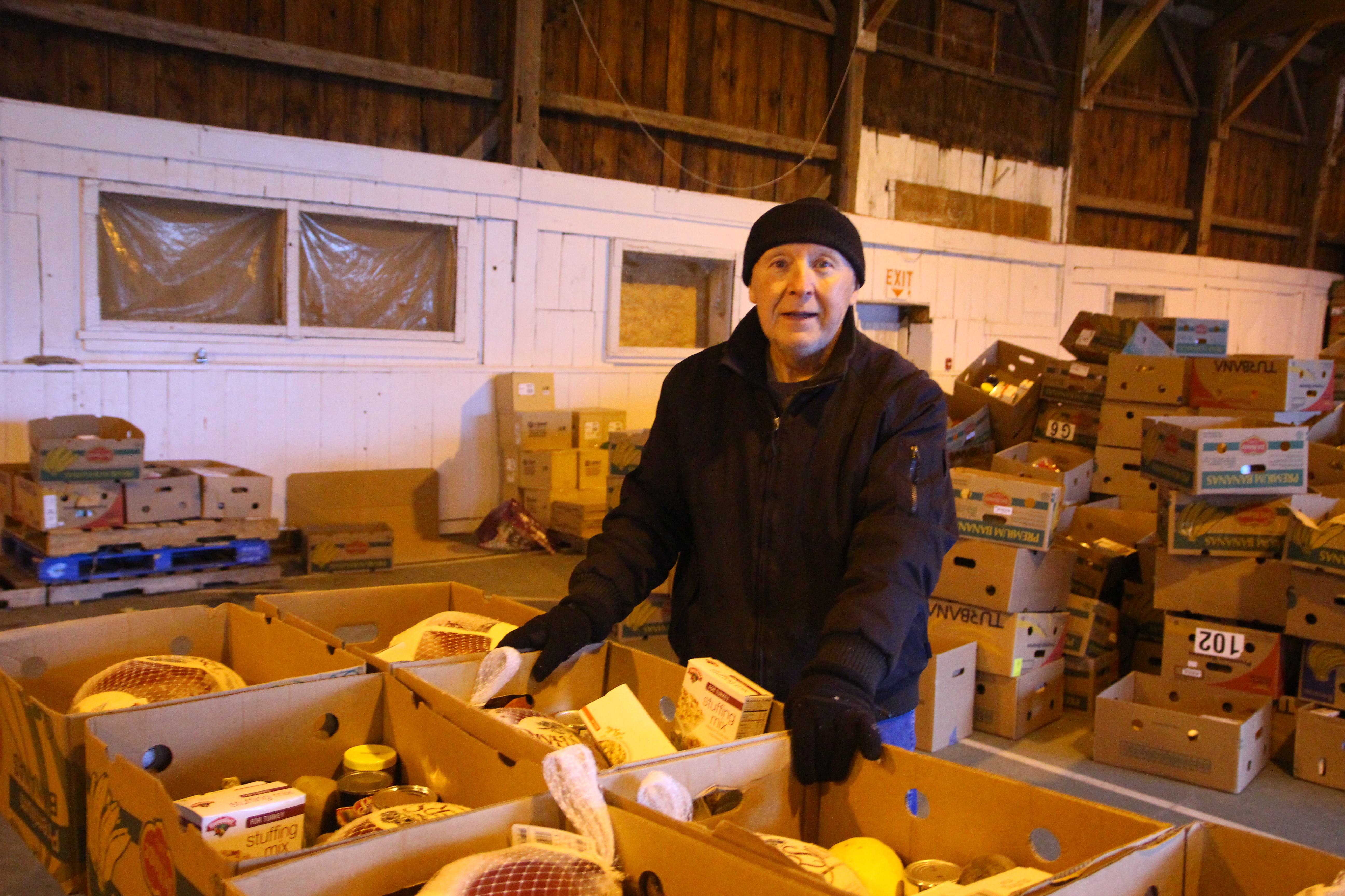 Ernie Cote of Shapleigh, a volunteer with the York County Shelter food pantry in Alfred, helps fill food boxes for the annual Thanksgiving distribution. The pantry expects to supply 1,500 to 2,000 Thanksgiving boxes this week. TAMMY WELLS/Journal Tribune