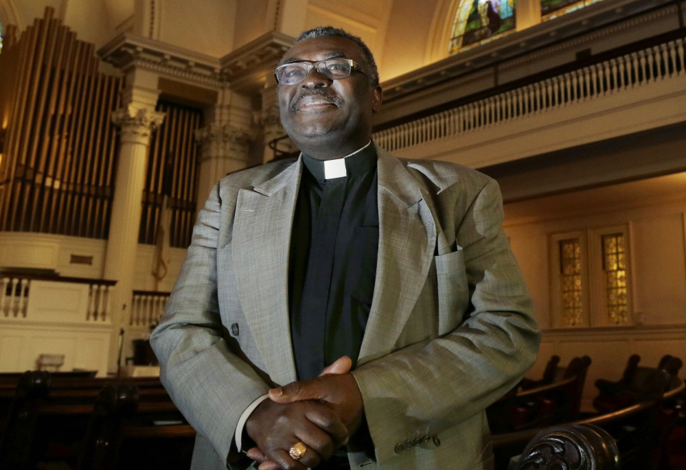 """Left: Abraham Waya, pastor of a Methodist Church in Brockton, Mass., tells people facing deportation: """"We will host you and take care of you for as long as it takes."""""""