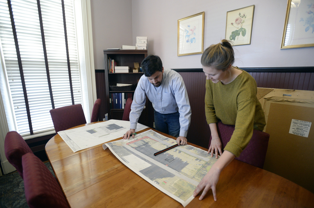 William Savage of Acorn Engineering in Portland looks over a site plan with design engineer Olivia Dawson on Thursday. <em>Shawn Patrick Ouellette/Staff Photographer</em>