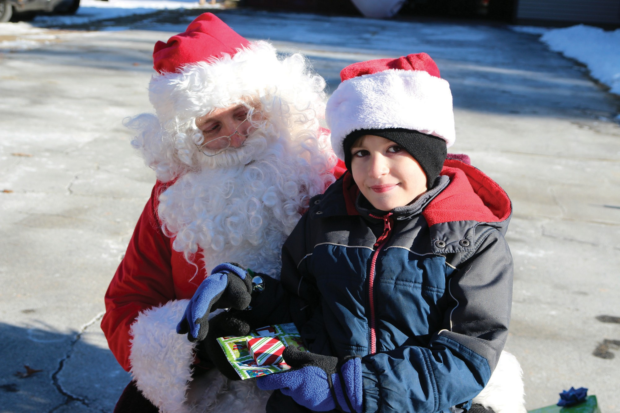 Jacob Riddle of Waterboro has a chat with Santa Saturday during the Riddle family's Christmas open house. The family invited folks from Waterboro and beyond to stop by their home on Old Alfred Road over the weekend to see Santa, meet Mrs. Claus, Frosty, the Christmas Mouse and other holiday characters. //TAMMY WELLS/Journal Tribune