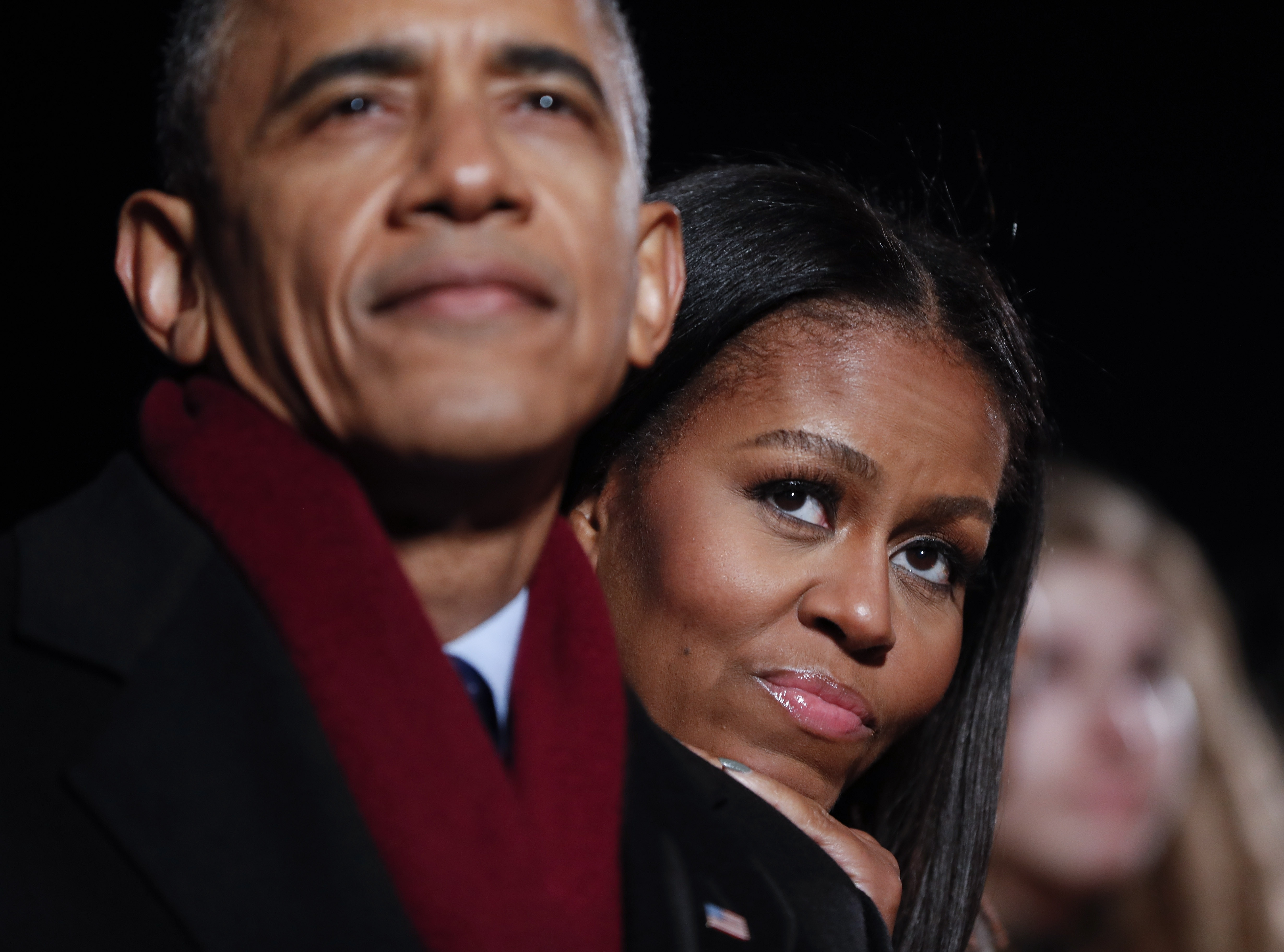 In this photo taken Dec. 1, first lady Michelle Obama and President Barack Obama watch the musical performances at the 2016 National Christmas Tree lighting ceremony at the Ellipse near the White House in Washington. What does Michelle Obama do next after leaving the White House? AP WIREPHOTO