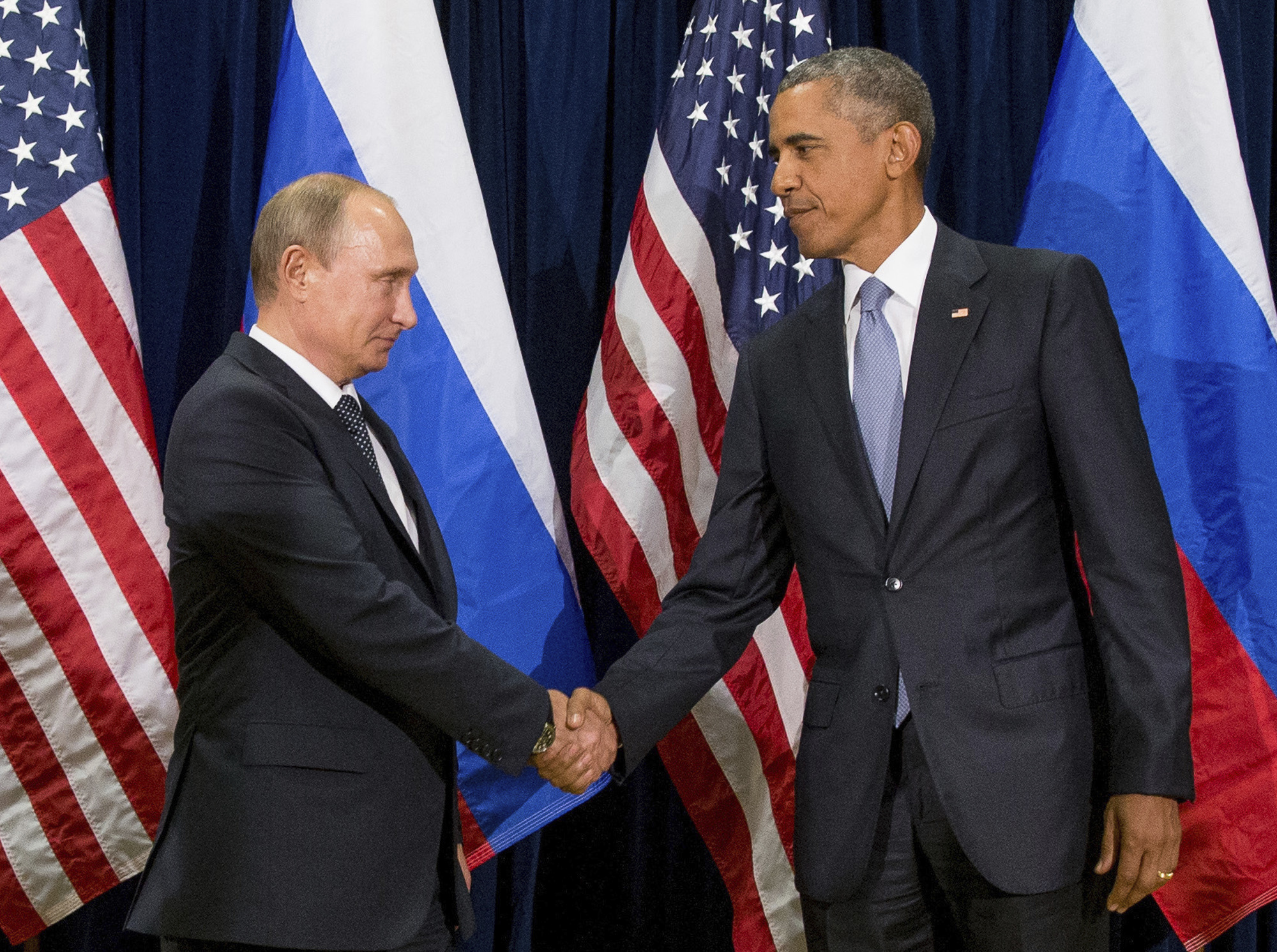 In this Sept. 28, 2015 file photo, President Barack Obama shakes hands with Russian President President Vladimir Putin before a bilateral meeting at United Nations headquarters.