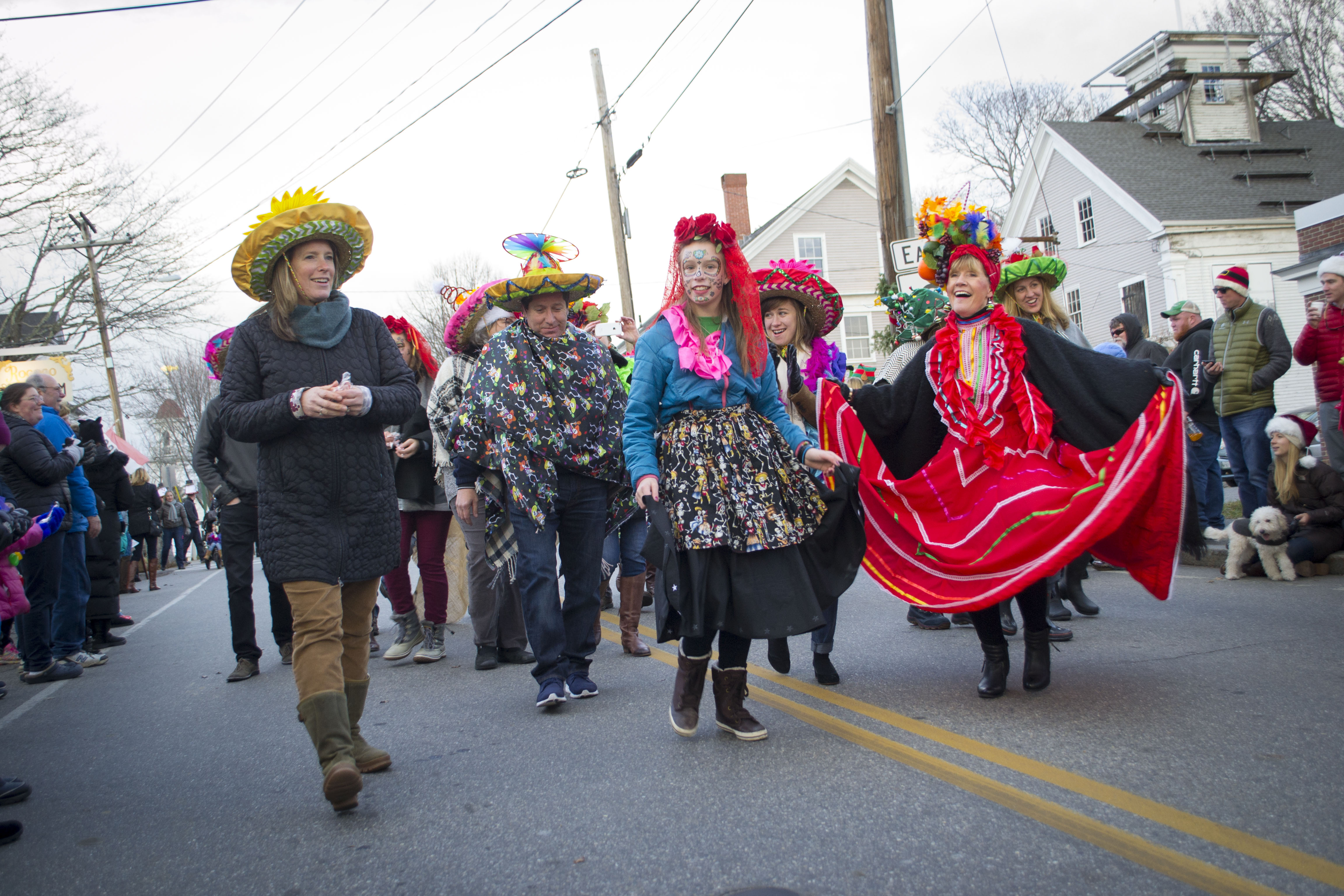 ALAN BENNETT/Journal Tribune. Marchers celebrate the holiday season by taking part in the 11th annual Hat Parade during Kennebunkport's 35th Christmas Prelude on Saturday.