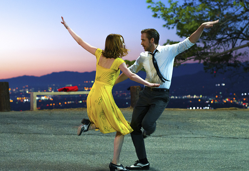 "Ryan Gosling, right, and Emma Stone in a scene from, ""La La Land."""
