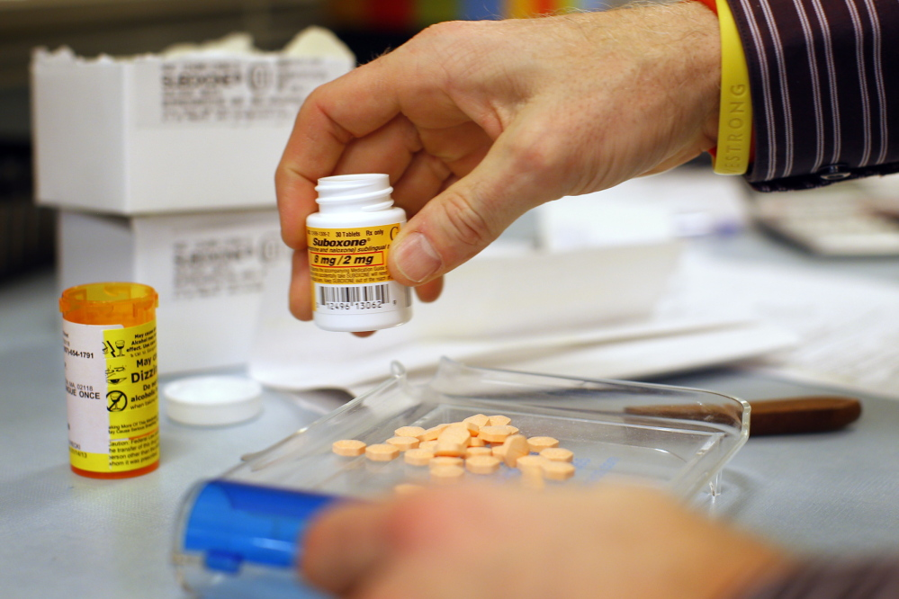 A pharmacist fills a Suboxone prescription at Boston Healthcare for the Homeless Program in Boston in this 2013 photo. Suboxone is an opiate replacement therapy drug that treats cravings and withdrawal symptoms.