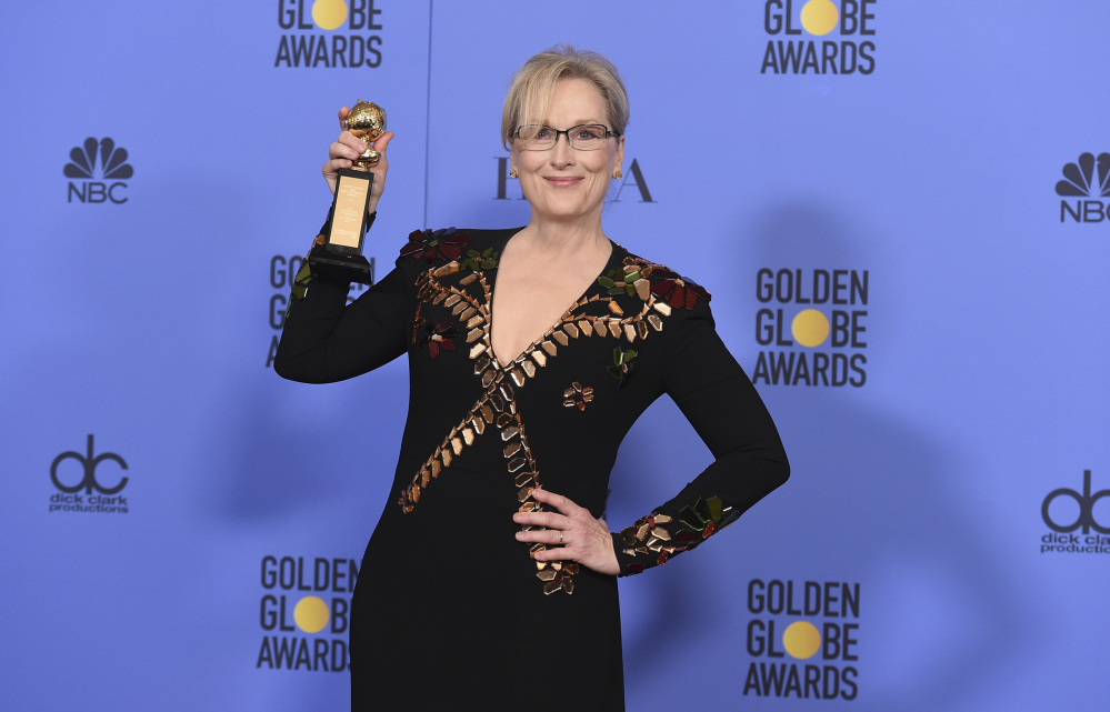 Meryl Streep poses in the press room with the Cecil B. DeMille award at the 74th annual Golden Globe Awards at the Beverly Hilton Hotel on Sunday, Jan. 8, 2017, in Beverly Hills, Calif.