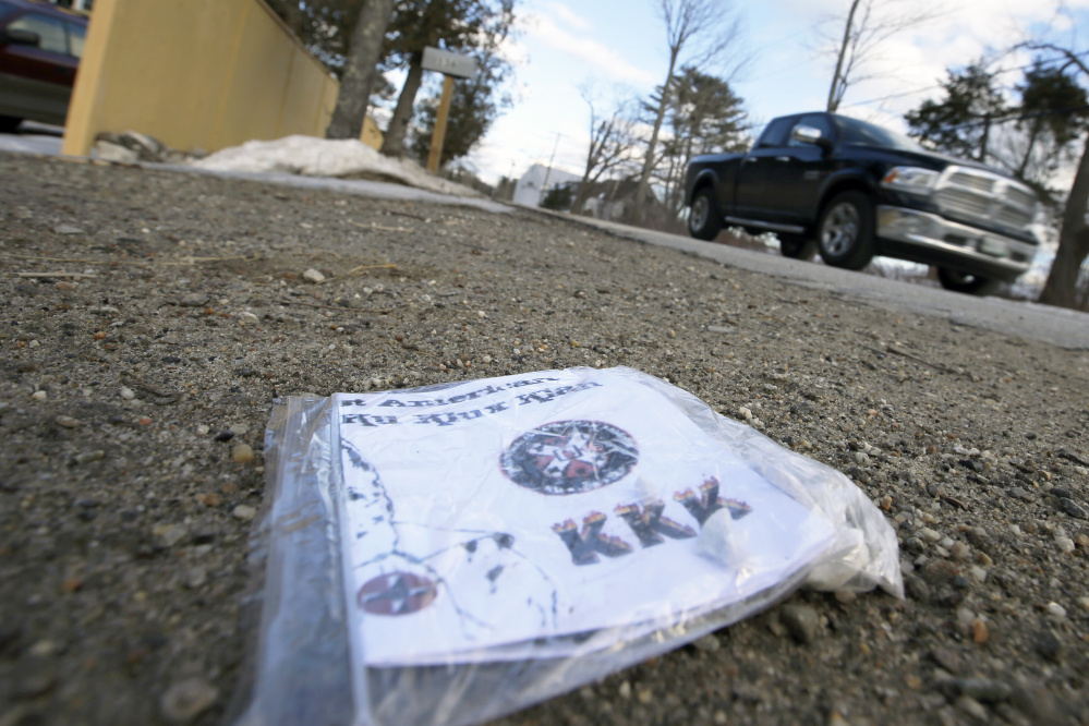 A truck passes near one of about two dozen Ku Klux Klan fliers left in driveways on South Freeport Road.