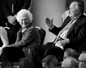 FORMER PRESIDENT GEORGE H. W. BUSH, right, and his wife, Barbara, are greeted before a Republican presidential primary debate at The University of Houston in Houston in this Febuary 2016 file photo. On Wednesday, the former president was admitted to an intensive care unit, and Barbara was hospitalized as a precaution, according to his spokesman.
