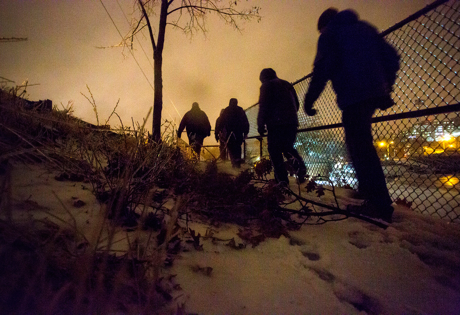 A team led by Oxford Street Shelter director Rob Parritt canvasses an Interstate 295 overpass near Fitzpatrick Stadium on Tuesday night during the annual point-in-time homeless count.