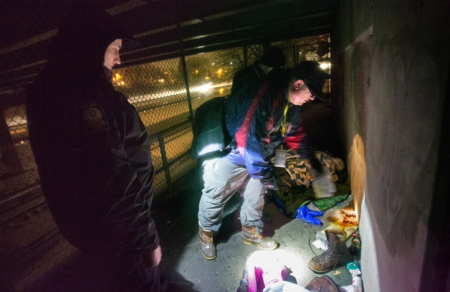 Rob Parritt looks through items after discovering an empty camp in a locked area under an Interstate 295 overpass near Fitzpatrick Stadium.