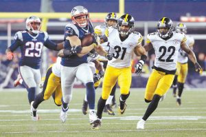 NEW ENGLAND PATRIOTS wide receiver Chris Hogan (15) runs against the Pittsburgh Steelers defense during the second half of the AFC championship NFL football game on Sunday in Foxborough, Mass. The Patriots rolled to a 36-17 victory.