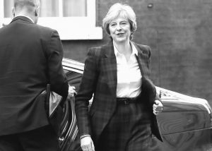 BRITISH PRIME MINISTER Theresa May arrives back at 10 Downing Street in London on Tuesday after making a speech setting out more details on the British government's approach to exiting the European Union.