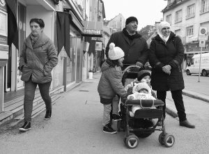 THE ALAHAMAD FAMILY enjoys their first walk in the town of Gray, in eastern France.