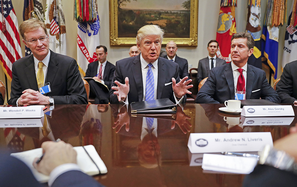 President Trump hosts a breakfast with business leaders in the Roosevelt Room of the White House Monday. At left is Wendell P. Weeks, CEO of Corning; at right is Alex Gorsky, chairman and CEO of Johnson & Johnson.