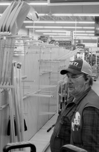 JOHN WOODCOCK stands next to a near empty aisle of snow shovels at a hardware store Wednesday in Falmouth. After three snowstorms in a week, residents doing battle with the flakes were running short of supplies as another winter storm arrived in Maine and New Hampshire.