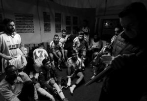COACH OF HOPE Refugee Football Club Antreas Sampanis, right, gives directions to his players before a soccer match in western Athens.