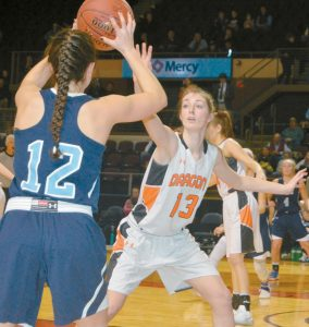 BRUNSWICK'S AIDAN SACHS (13) defends against York's Martha McCaddin during a girls high school basketball Class A South semifinal at Cross Insurance Arena in Portland on Wednesday. Sachs had 11 points as the Dragons captured a 43-35 victory.