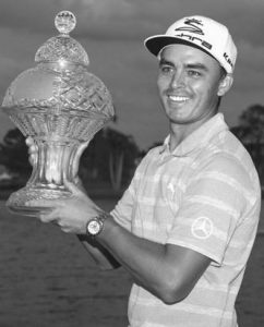 PRO GOLFER Rickie Fowler holds up the Honda Classic trophy after the conclusion of the golf tournament in Palm Beach Gardens, Fla., on Sunday.
