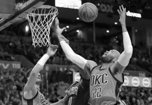 OKLAHOMA CITY THUNDER forward Taj Gibson, right, and center Steven Adams, left, and New Orleans Pelicans forward DeMarcus Cousins (0) reach for a rebound during the first half of an NBA basketball game in Oklahoma City on Sunday.