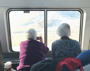 TWO WOMEN take photos of the Sierra Nevada mountains on the California Zephyr train. AP Tampa correspondent Tamara Lush spent 15 days traveling via train across the U.S. as part of Amtrak's residency program, designed for creative professionals to spend time writing on the rails. She spoke with dozens of people and filed occasional dispatches for the Tales on a Train project.