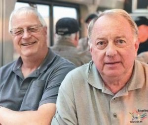 TOM SCHULTZ, 68, and Joe Krueger, 60, of Watertown, Wisconsin, talk about their love of trains since boyhood along the rails.