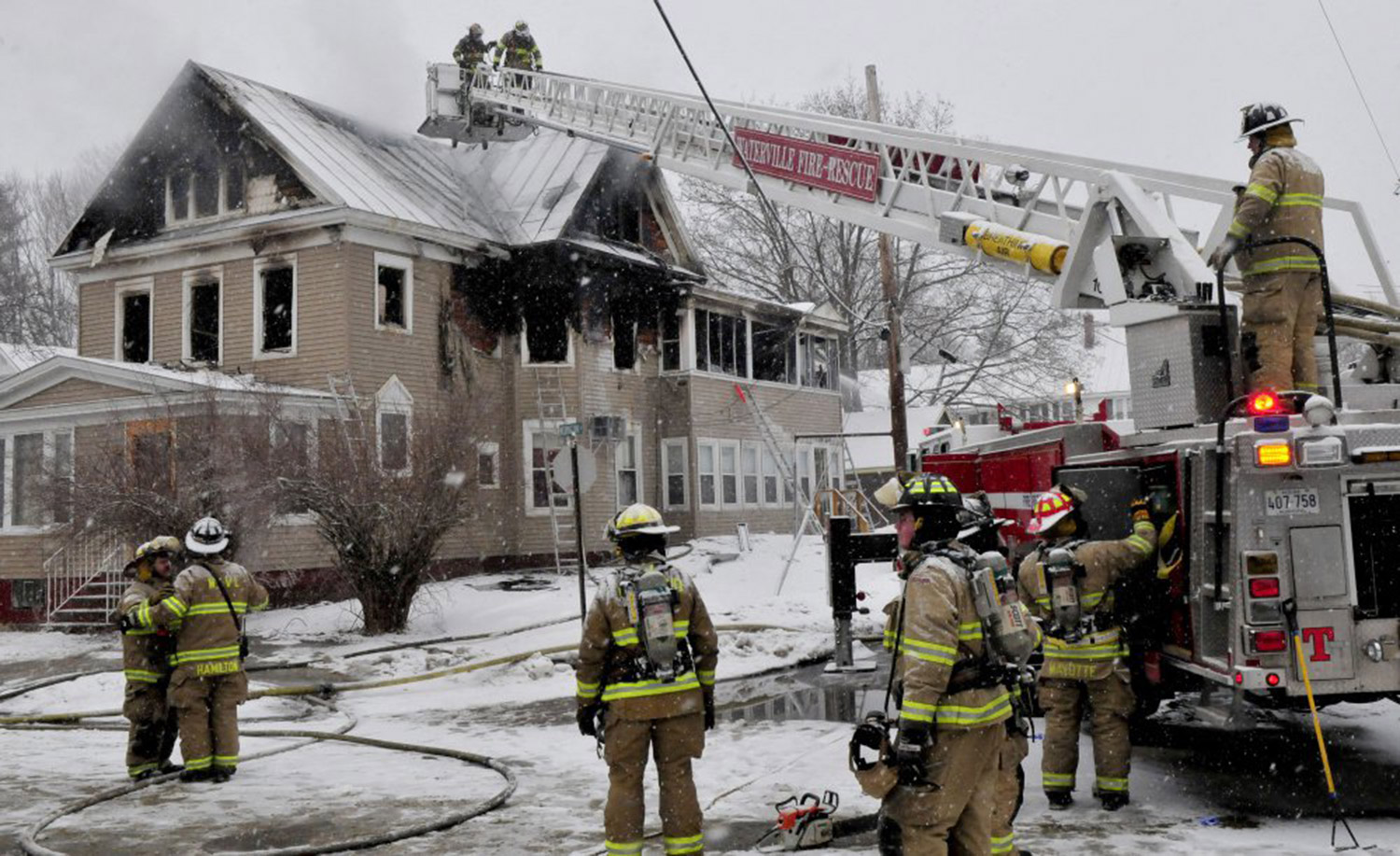 Dozens of firefighters from neighboring departments fight a fire that destroyed an apartment building on Summer Street in Waterville early Wednesday morning.