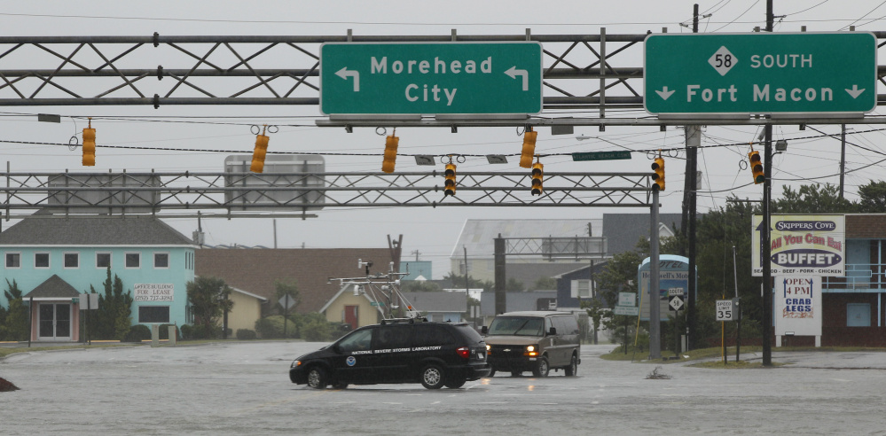 "A NOAA storm vehicle turns around to avoid flood waters in Atlantic Beach, N.C., during Hurricane Irene in 2011. Proposed cuts would eliminate funding for some of the agency's smaller programs such as its ""coastal resilience"" initiative,  aimed at protecting coastlines."