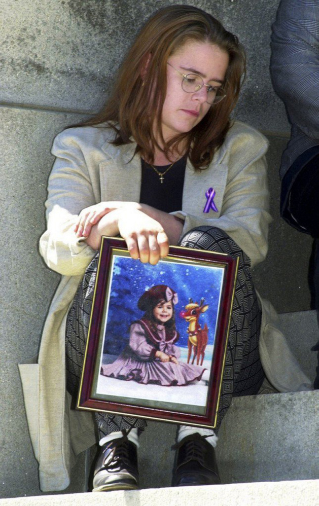 Christy Darling sits with a portrait of her daughter Logan Marr, who died 16 years ago while in foster care. Sally Ann Schofield, who was convicted of manslaughter in Logan's death, is scheduled to be released from prison on probation in April.