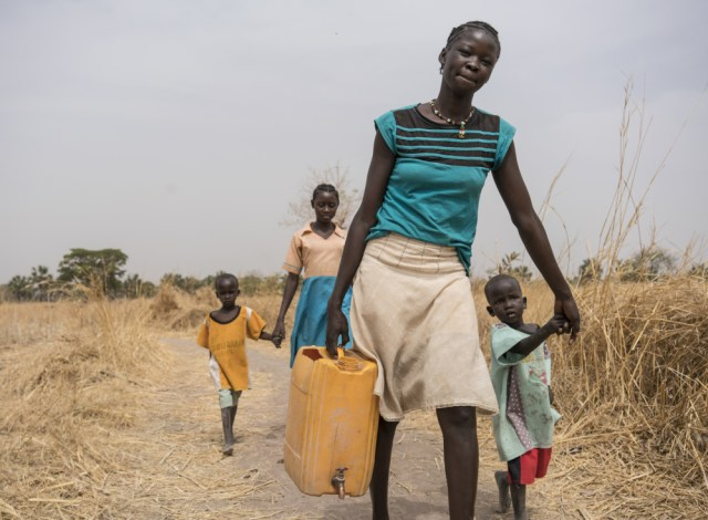 A family has to walk several miles to bring clean water to their home in South Sudan, one of multiple African countries dealing with sparse supplies of safe drinking water for a population that's growing quickly.