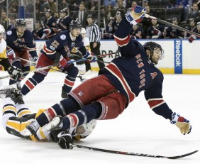 Pittsburgh defenseman Mark Streit, bottom, trips New York Rangers right wing Rick Nash during the second period of the Penguins' 4-3 win in overtime at New York.