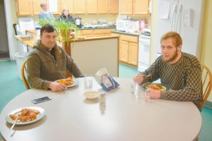A MEAL IS SHARED at Tedford Housing's Cumberland Street unit in Brunswick on Tuesday.