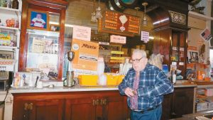 """FRANK ANICETTI, owner of Kennebec Fruit Co., is pictured in the """"Moxie store,"""" which after being on the market for several months, was sold to Tony and Traci Austin on Friday."""