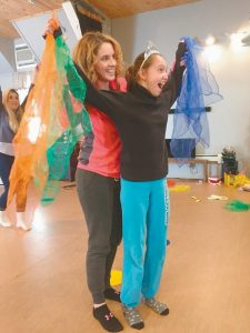 CHILDREN WITH CHALLENGES instructor Kate Andreu works with student Jaclyn Sweet during a class at New England Regional Theater Company in Brunswick.